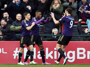 West Ham United's Diafra Sakho (C) celebrates with team mates Aaron Cresswell (L) and Andy Carroll after scoring a goal against Bristol City during their FA Cup fourth round soccer match at the Ashton Gate Stadium