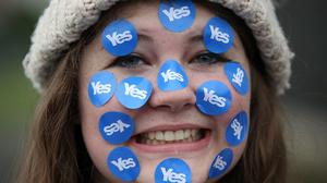 "A women wears stickers on her face on a ""short walk to freedom"" march in Edinburgh, Scotland September 18, 2014."