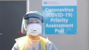 An Emergency Department Nurse during a demonstration of the Coronavirus pod and COVID-19 virus testing procedures set-up beside the Emergency Department of Antrim Area Hospital, Co Antrim in Northern Ireland. Photo: Michael Cooper/PA Wire