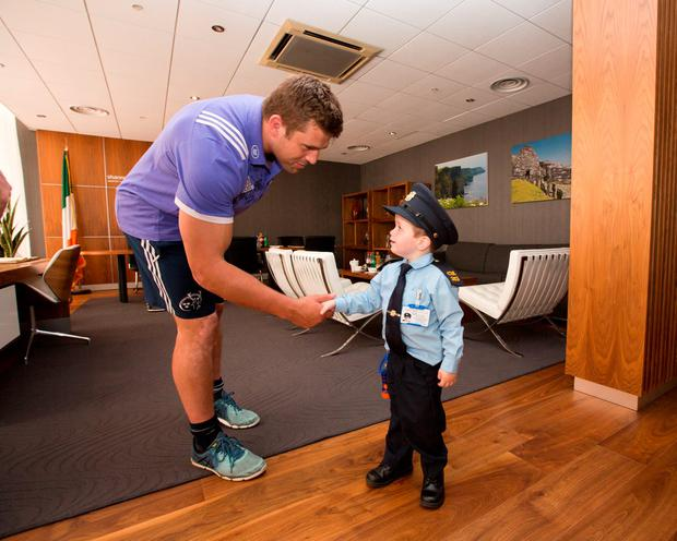 Garda Ceejay McArdle meets hero rugby player CJ Stander at Shannon Airport.