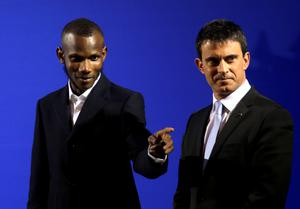 French Prime Minister Manuel Valls, right, awards citizenship to Lassana Bathily during a ceremony in Paris. (AP Photo/Christophe Ena)