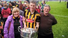 Picture of deceased farmer Johnny Ryan with his wife Lilly and son Lester (Kilkenny captain) after league final in Semple Stadium, Thurles, last year