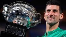 Serbia's Novak Djokovic holds the Norman Brookes Challenge Cup after defeating Russia's Daniil Medvedev