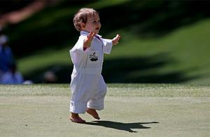 Sophia, the daughter of Louis Oosthuizen of South Africa, runs across the first green  during the annual Par 3 contest ahead of the 2013 Masters golf tournament at the Augusta National Golf Club. Photo: Reuters