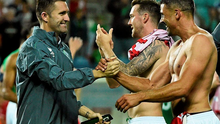 Robbie Keane celebrates at the end of the game with Jonathan Walters.