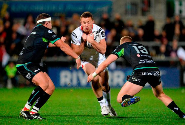 Ulster's Tommy Bowe is tackled by Ospreys' Nicky Smith and Ben John. Photo: Oliver McVeigh/Sportsfile