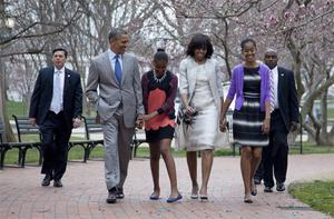 President Barack Obama and first lady Michelle Obama walk from the White House with their daughters Sasha Obama, second from left, and Malia Obama, right, on their way through Lafayette Park to St. John's Episcopal Church for Easter services
