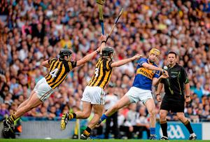 JJ Delaney and Jackie Tyrrell, Kilkenny, try to close down Tipperary's Seamus Callanan. Picture credit: Piaras Ó Mídheach / SPORTSFILE