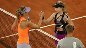Winner in three sets Eugenie Bouchard of Canada shakes hands with Maria Sharapova of Russia during day three of the Mutua Madrid Open tennis at La Caja Magica on May 8, 2017 in Madrid, Spain.  (Photo by Julian Finney/Getty Images)