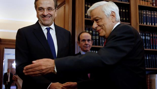 Former Greek conservative Prime Minister Antonis Samaras (L), leader of the opposition New Democracy party, shakes hands during a meeting with Greek President Prokopis Pavlopoulos (R) at the Presidential Palace in Athens, Greece June 28, 2015. Europe's grand project to bind its nations into an unbreakable union by means of a common currency lurched into uncharted waters after EU governments refused funding to save Greece from defaulting on its debts.  REUTERS/Alkis Konstantinidis