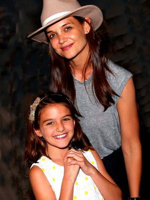 """Suri Cruise and mother Katie Holmes pose backstage at the hit musical """"Finding Neverland"""" on Broadway at The Lunt Fontanne Theatre on July 30, 2016 in New York City.  (Photo by Bruce Glikas/Bruce Glikas/FilmMagic)"""