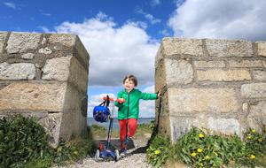 'Feeling pleasant': Three-year-old Danny McNicholas enjoys the sunshine on the West Pier at Dún Laoghaire yesterday. Photo: Frank McGrath