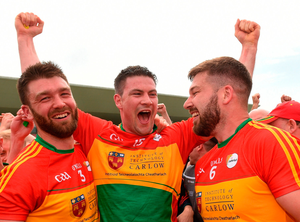 TURN-UP: Carlow captain John Murphy celebrates with Shane Redmond (left) and Daniel St Ledger (right) after a famous Leinster Championship win over Kildare. Photo by Matt Browne/Sportsfile