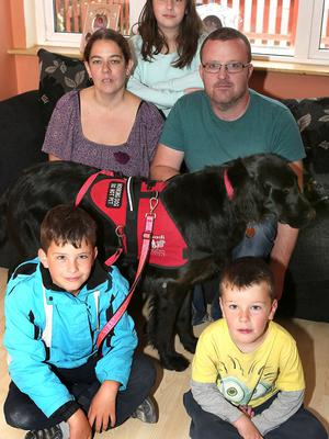 "Luke Gilligan ( seated  on left ) with his guide dog ""Skye"" brother, Ryan (5) and sister Casey (11) and parents - Liesa and Paul  , at their home in Portlaoise. Photo; Michael Scully."
