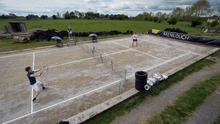 Christopher and James Craughwell play on their silage pit turned tennis court in Menlough, Co Galway. Picture: Ray Ryan
