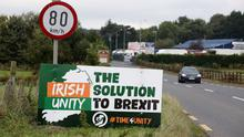 Opinion split: An anti-Brexit pro-Irish unity billboard on the Dublin road in Newry, Co Down. Photo: Getty Images
