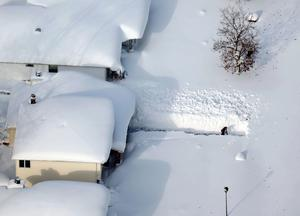 A man digs out his driveway in Depew, New York.