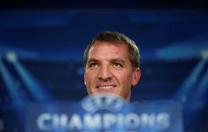 Liverpool's coach Brendan Rodgers smiles during a news conference at Santiago Bernabeu stadium in Madrid