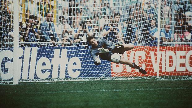 25 June 1990; Republic of Ireland goalkeeper Packie Bonner saves Romania's Daniel Timofte's shot during the penalty shoot-out. 1990 FIFA World Cup, Second Round, Republic of Ireland v Romania, Stadio Luigi Ferraris, Genoa, Italy. Picture credit; Ray McManus / SPORTSFILE