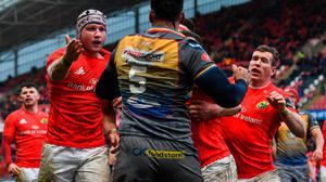 Sam Lousi of Scarlets throws a punch at Fineen Wycherley of Munster, resulting in a red card, during the Guinness PRO14 match at Thomond Park in Limerick. Photo: Ramsey Cardy/Sportsfile