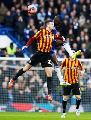 Chelsea's Ramires (R) challenges Bradford City's Andy Halliday during their FA Cup fourth round soccer match at Stamford Bridge in London January 24, 2015. REUTERS/Stefan Wermuth (BRITAIN - Tags: SPORT SOCCER)