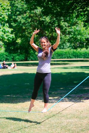 Tanya Cross from Sydney performs on a tightrope whilst enjoying the good weather in Stephens Green,Dublin. Photo: Gareth Chaney Collins