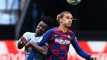 Joseph Aidoo of RC Celta Vigo is tackled by Antoine Griezmann of FC Barcelona during a recent La Liga match. (Photo by Octavio Passos/Getty Images)