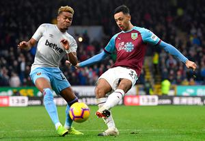 Burnley's Dwight McNeil and West Ham's Grady Diangana battle for possession. Photo: Getty Images