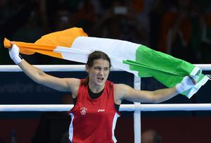 Katie Taylor of Ireland celebrates defeating Sofya Ochigava of Russia to win gold during the women's boxing Lightweight final of the 2012 London Olympic Games