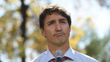 """Canada's Prime Minister Justin Trudeau addresses the media in Winnipeg, Manitoba, Thursday, Sept. 19, 2019. Trudeau's campaign was hit Wednesday by the publication of a yearbook photo showing him in brownface makeup at a 2001 costume party. The prime minister apologized and said """"it was a dumb thing to do."""" (Sean Kilpatrick/The Canadian Press via AP)"""