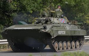 Pro-Russian rebels ride on an APC near the village of Berezove, eastern Ukraine, Thursday, Sept. 4, 2014, after a clash between pro-government troops and Russian-backed separatist militia