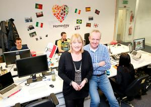 Co-founder Tom Kennedy in the Homestay offices with Debbie Flynn.