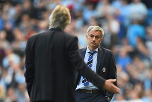 Jose Mourinho of Chelsea speaks with Manuel Pellegrini of Manchester City