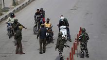 Indian paramilitary soldiers enforce restrictions in Srinagar, Indian controlled Kashmir, Sunday, March 22, 2020 (AP Photo/Mukhtar Khan)