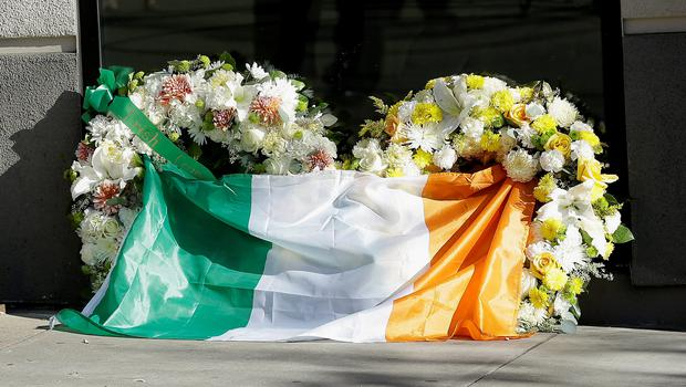 A flag of Ireland is draped over wreaths at the Library Gardens apartment complex in Berkeley, Calif., Tuesday, June 16, 2015. (AP Photo/Jeff Chiu)