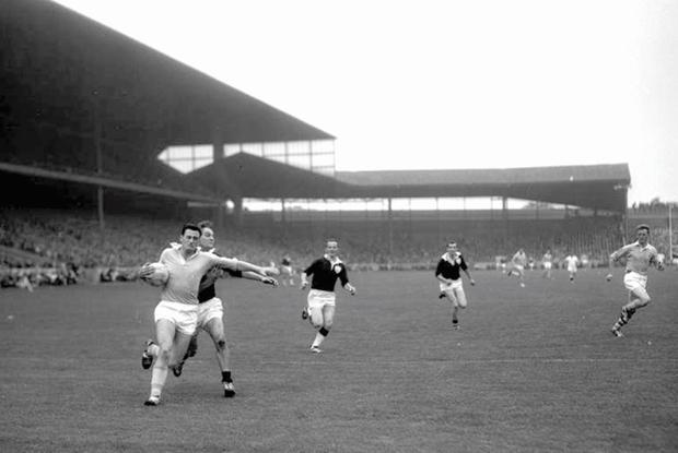 Mickey Whelan carries the ball in the 1963 All-Ireland football final