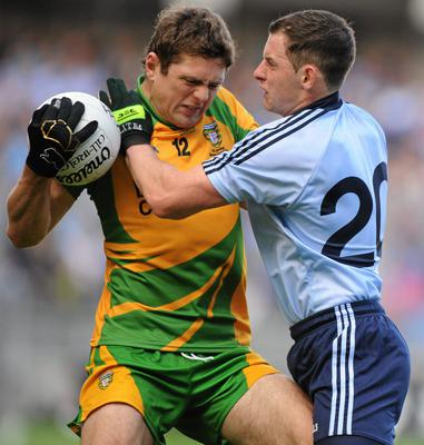 Philly McMahon in action against Donegal's Ryan Bradley during the 2010 All-Ireland SFC semi-final at Croke Park. Photo: Oliver McVeigh/Sportsfile