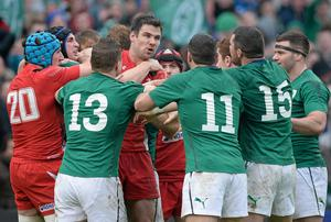 Mike Phillips of Wales tussles with Ireland players after Paddy Jackson scored Ireland's second try