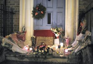 Flowers and cards pictured in the door way where Jonathan Corrie died on Dublins Molesworth Street. Photo: Frank Mc Grath