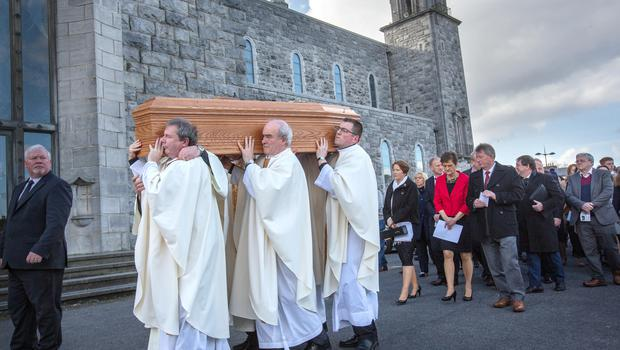 The coffin of Bishop Eamonn Casey followed by members of his family is taken to the crypt at the Cathedral of Our Lady Assumed into Heaven and St. Nicholas in Galway during his funeral. Photo: Tony Gavin