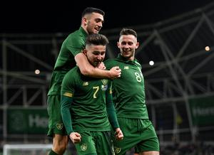 Sean Maguire , centre, is congratulated by team-mate Troy Parrott, left, and Alan Browne after scoring Ireland's second goal during the friendly win over New Zealand at the Aviva Stadium in Dublin last November. Photo: Seb Daly/Sportsfile