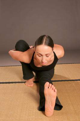 Woman in the Marichyasana posture B pose which was attempted by the man who broke his femur