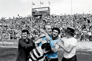 Dublin's Brian Mullins, left, and team-mate Ciarán Duff celebrate with supporters after the final whistle in the All-Ireland Senior Football Championship Semi-Final Replay against Cork at Páirc Uí Chaoimh