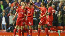 Jordan Rossiter of Liverpool celebrates with team mates after scoring the opening goal during the Capital One Cup Third Round match at Anfield
