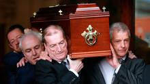 Ciaran Haughey helps to carry his uncle's coffin. Photo: Frank McGrath