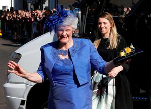 Tennis player Andy Murray's grandmother Shirley Erskine waves as she arrives for his wedding to his fiancee Kim Sears in Dunblane
