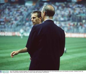 June 1990; Republic of Ireland Manager Jack Charlton has a quick word with Captain Mick McCarthy immediatley prior to the Republic of Ireland  v Holland, World Cup Finals, Group Match, Palermo, Italy. Soccer. Picture credit; Ray McManus / SPORTSFILE