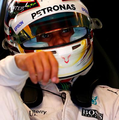 Lewis Hamilton enjoys a quiet moment outside the Mercedes garage during practice in Barcelona yesterday