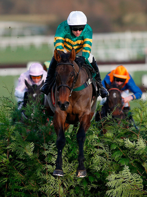 Mark Walsh and Cantlow skip clear over the final fence to land the Glenfarclas Cross Country Chase at Cheltenham. Photo: Alan Crowhurst/Getty Images
