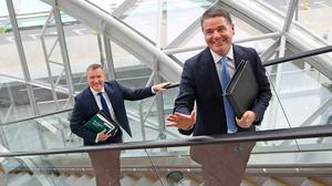 Only way is up: Michael McGrath and Paschal Donohoe (right) before announcing the Budget. Photo: Julien Behal Photography/PA Wire